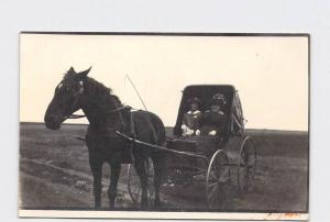 RPPC REAL PHOTO POSTCARD HORSE PULLING BUGGY WITH WOMAN AND GIRL GREAT HATS DRES