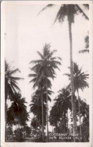 RPPC-Paupa, New Guinea Cocoanut Trees WWII No. 6 Grogan Photo
