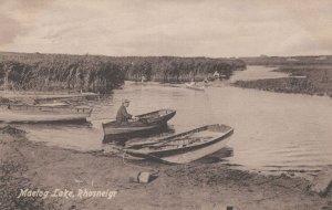 Rowing Boat & Welsh Man at Maelog Lake Anglesey Wales Old Postcard