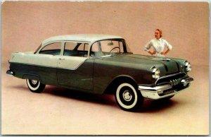 1955 PONTIAC 860 2-Door Sedan Car Adv. Postcard Castle Grey Over Falcon Grey