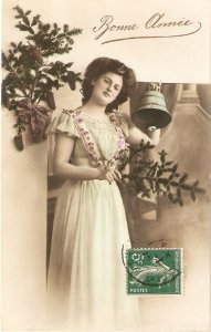 Lady with pinetree branch, ringing the bell Vintage French New Year Greeting p