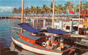 Fort Myers Florida~Yacht Basin~Couple Sitting on Colorful Sailboat~'50s Postcard