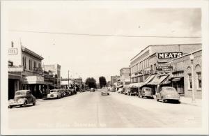 Street Scene Okanogan WA Baum Hotel Leonard Cafe Ellis 2056 RPPC Postcard E46