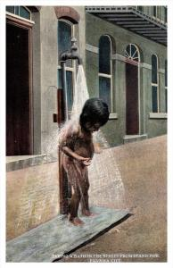 1889  Panama Child taking bath in the street  from stand pipe
