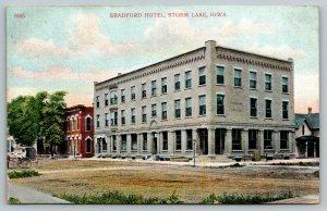 Storm Lake Iowa~Bradford Hotel~Buildings on Street~House Behind~1914 Postcard