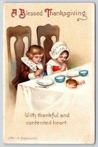 Ellen H Clapsaddle Thanksgiving~Pilgrim Children Pray at Table~Contented Hearts