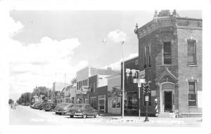 O'Neill Nebraska~Douglas Street @ 4th~Corner Barber Shop~Cleaner~1940s Cars~RPPC