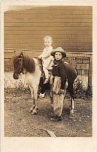 G58/ Interesting RPPC Postcard c1910 Cute Cowboy Children Pony 26