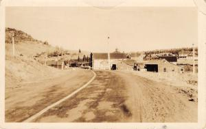 Real Photo Postcard~Highway Into Town~on Side: Last Store to State Park~1920s