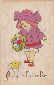 EASTER, PU-1915; Girl holding basket of colored eggs walking after chick