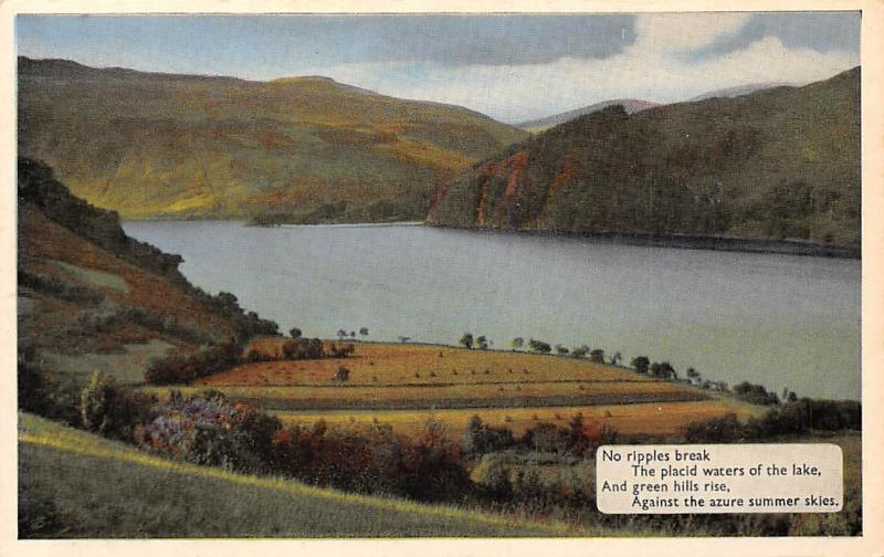 Ireland No ripples break, placid waters of the lake, green hills