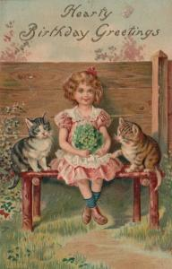 BIRTHDAY, PU-1910; Girl sitting with bouquet and two kittens