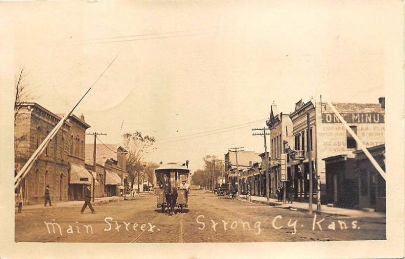 Strong KS Horse Drawn Trolley Dirt Street View Store fronts Real Photo Postcard
