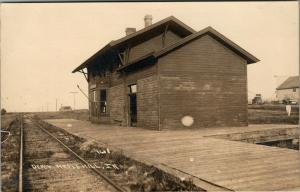 Maple Hill-Armstrong IA~Ghost Town Railway Depot~Platform~Farm Machine~1910 RPPC