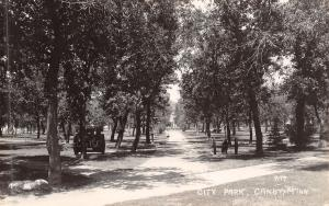 Canby Minnesota~City Park~Cannon in the Trees~Girl on Path~Tractor~1930s RPPC