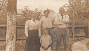 B41/ Wellsburg West Virginia WV RPPC Postcard Family Home Smile