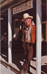 Dan Blocker stands on the porch of the Silver Dollar Saloon 1960s