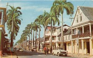 Suriname~Street Scene~Person on Bicycle~Houses~50s Cars~Postcard