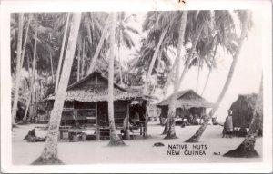 RPPC-Paupa, New Guinea Native Huts WWII No. 1 Grogan Photo