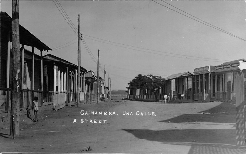 G42/ Foreign RPPC Postcard Cuba Caimanera c1920s Una Calle Street Homes Store