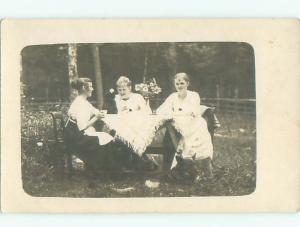 rppc c1910 WOMEN SITTING OUTDOORS AT TABLE AC8836
