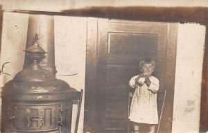 Real Photo Postcard~Baby With Bottle~Chair Next to Pot Bellied Stove~c1912 RPPC