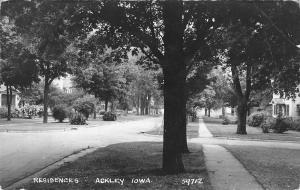 Ackley Iowa~Residential Neighborhood~Homes in Summertime~Trees~Bushes~1940s RPPC