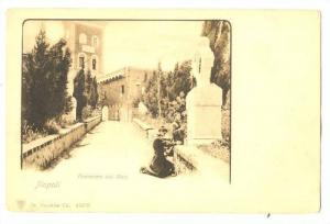 Two boys worshipping statue, Panorama dal Molo, Napoli, Campania, Italy, 10-20s