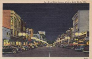 Broad Street, Store fronts, looking West at Night, Elyria, Ohio, 30-40s