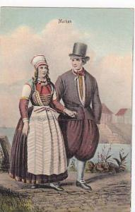 Couple takng a stroll dressed in traditional attire, Marken, North Holland, N...