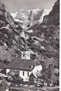 Switzerland Grindelwald Kirche mit Fiescherhoerner Photo