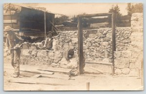 RPPC~A Pair of Stone Masons Build Walls in the Mud~Wagon Wheel~Chicken Coop~1910