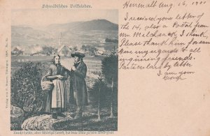 German Man and Woman on a road overlooking town, PU-1900