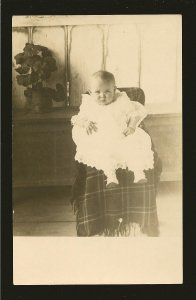 Vintage Portrait of Young Child Seated in a Chair Real Photo Postcard Unposted
