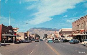 1960s City Street Scene Cody Wyoming autos Coca Cola Enterprise postcard 5442