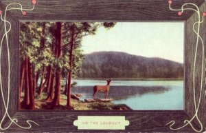 ON THE LOOKOUT Stag stands on shore looking out over lake 1909
