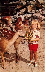 Deer Ranch Silver Springs Florida Cute Little Girl shares Lollipop Postcard