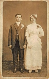 MARRIAGE OF YOUNG MAN & WOMAN~REAL PHOTO POSTCARD
