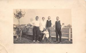 Real Photo Postcard~Family by Wire Fence~Tot on Iron Tricycle~Houses~1912 RPPC