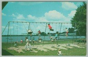 Warsaw Indiana~Center Park Lake~Kids on Swingset~Girls Stand on Swings~1958