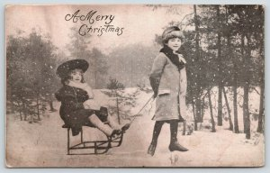 Victorian Christmas~Boy Pulls Little Sister on Sled Chair~B&W 1905 Postcard