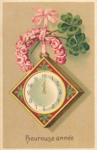 Postcard Early embossed greetings heureuse anne clock luck flowers decoration