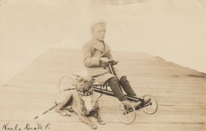 RP: Dog & Boy in pedal car , Minnesota , 1908