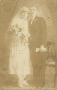 Social historywedding groom & bride early photo postcard