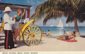 NASSAU, Bahamas, PU-1955; British Colonial Beach, Officer Helping A Woman