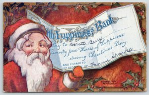 Christmas~Santa Holds Check from Bank of Happiness~Embossed~HI Robbins~1908