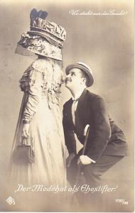 Netherlands - Women in Hat with Man Trying to See Her Face.