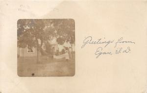 Egan South Dakota~Lady & Girl by Hammock in Front of House~Note on Bk~1910 RPPC