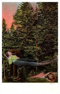 Lovers kissing in Hammock