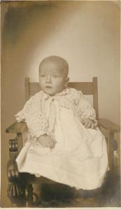 16 Dexter Ave~Bald Baby Girl in Wooden Kid's Chair~Bremer Studio RPPC c1918
